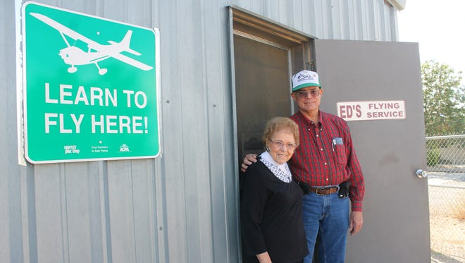 Ed's Flying Service owner Bob Pavelka stands with his mother Angie Pavelka in front of their hangers. Ed's Flying Service was started by Bob's father, Ed Pavelka, 50 years ago this year.