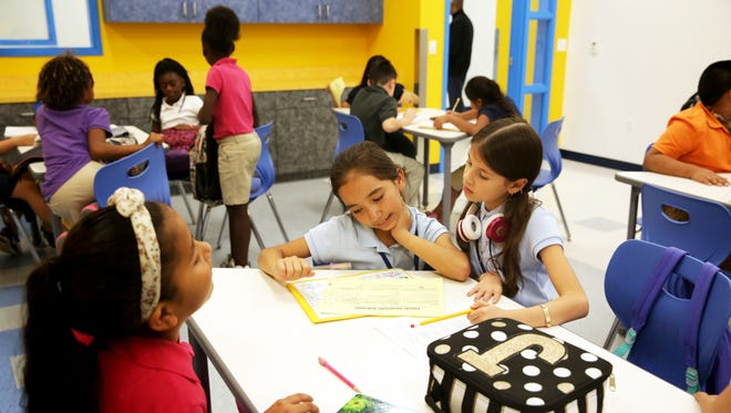 Students work on school work at the Boys & Girls Club of Collier County Bolch Campus in Immokalee on Thursday, Nov. 17, 2016.
