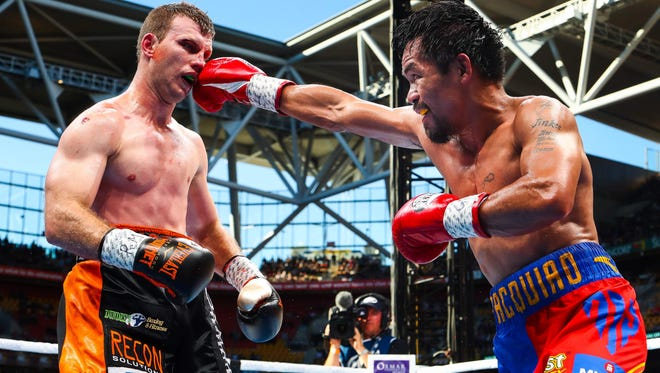 Manny Pacquiao (R) of the Philippines fight Jeff Horn (L) of Australia during the World Boxing Organization boat at Suncorp Stadium in Brisbane on July 2, 2017.