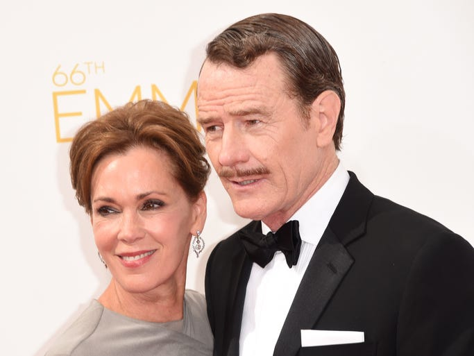 LOS ANGELES, CA - AUGUST 25:  Actor Bryan Cranston (R) and Robin Dearden attend the 66th Annual Primetime Emmy Awards held at Nokia Theatre L.A. Live on August 25, 2014 in Los Angeles, California.  (Photo by Jason Merritt/Getty Images)