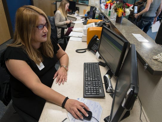 Front desk receptionist Ana Martinez demonstrates how