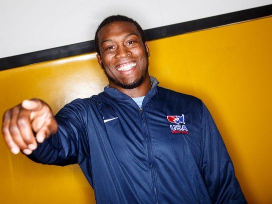 Kyven Gadson, Team USA wrestler at 97 kilograms stands