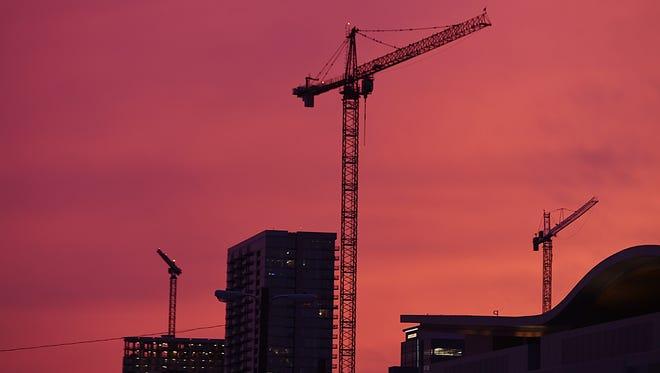 Construction cranes spot the downtown Nashville skyline.