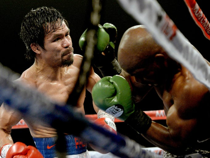 Timothy Bradley Jr. (green gloves) and Manny Pacquiao (red gloves) during their WBO World Welterweight Championship fight at MGM Grand Garden Arena.