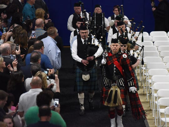 Bagpipers lead the procession at Mount Saint Mary College's
