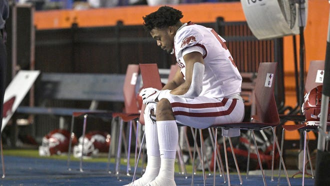 Arkansas running back Rakeem Boyd (5) sits the bench during the first half against Florida on Nov. 14 in Gainesville, Fla.