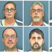 Six agents of a bonding company were charged with burglary and assault