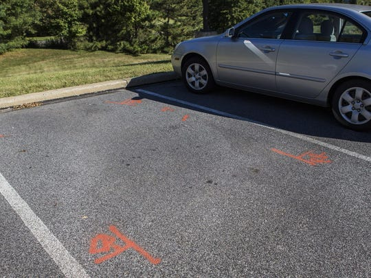 Spray paint marks the location of Shazim Uppal's car in the parking lot of the Franciscan Care Center.
