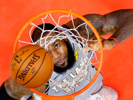 FILE - In this March 9, 2018 file photo, Cleveland Cavaliers forward LeBron James watches his shot go in during the second half of the team's NBA basketball game against the Los Angeles Clippers,  in Los Angeles. James has mastered the first-round knockout.  One of the most dominant postseason players in NBA history, James is undefeated in opening series, a perfect 12-0 since making his playoff debut with the Cavaliers back in 2006. He's 48-7 in the first round, and his teams in Miami and Cleveland have ripped off 21 straight victories, a winning streak that stretches to 2012 with the Heat. (AP Photo/Mark J. Terrill, File)