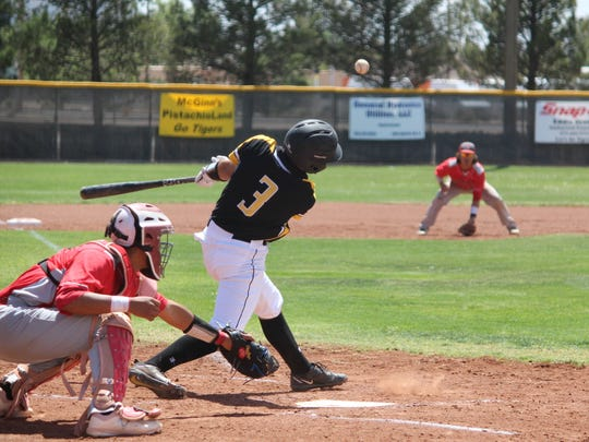 Alamogordo Tiger Grayson Guerra gets a hit during their 4-3 loss to Valencia Saturday.