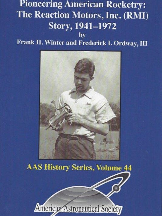 Cover, book on RMI, showing Wyld holding his motor, 1941