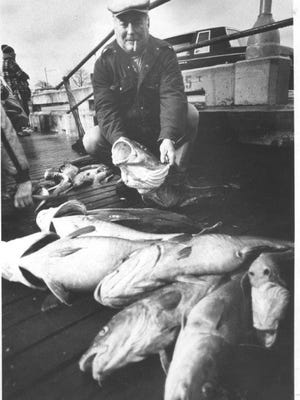 A file photo from 1981 shows an angler with his catch of codfish on a party boat out of Belmar.
