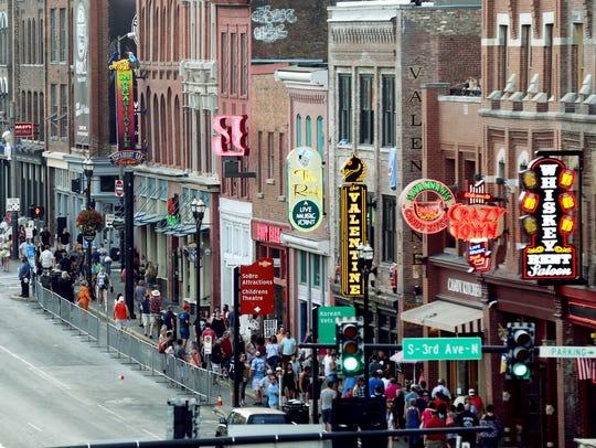 Folks walk along Lower Broadway on Aug. 27, 2017.