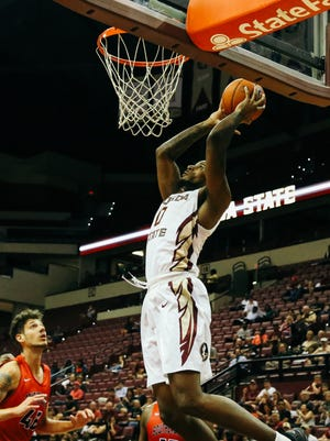 Phil Cofer goes up for a dunk in FSU's exhibition win over Southeastern.