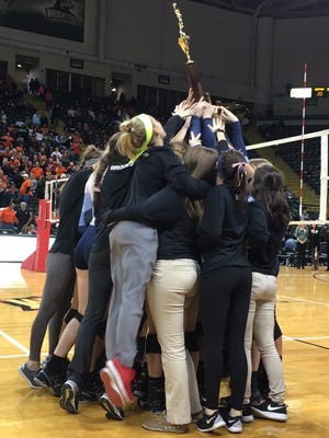 Mt. Notre Dame hoists its championship trophy after winning the final Saturday.