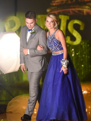 Taylor Thelen and Johnny Goehring smile during prom