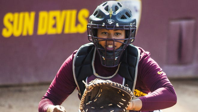 Arizona State University softball catcher Amber Freeman catches the ball during practice at ASU in Tempe on May 5, 2015.
