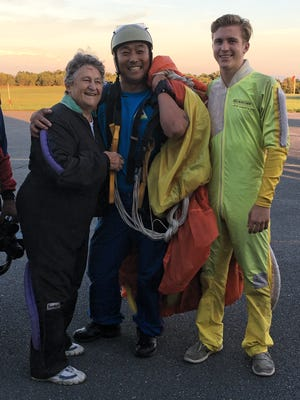Judy Helfrick, diving instructor Chul Yong Lee and Helfrick's grandson Cole Schmidt get ready to skydive at Chambersburg Airport