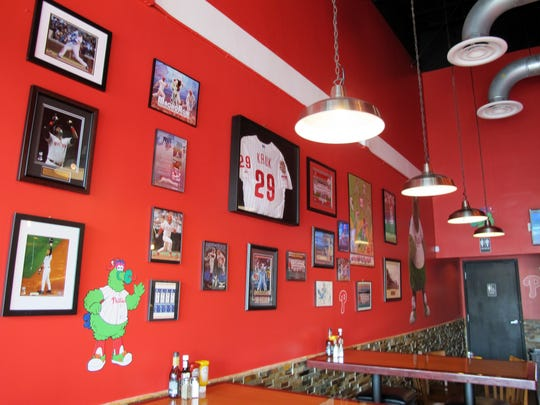 Kruk's Philly Steaks, which opened March 30 in North Naples, features baseball memorabilia from former Philadelphia Phillies slugger John Kruk, a Naples resident who co-owns the new local eatery.