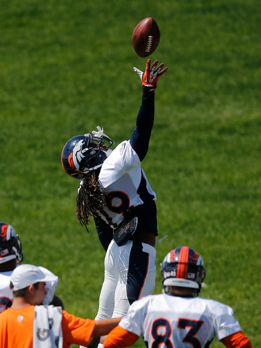 Denver Broncos' Isaiah Burse jumps up to catch a pass during a drill at NFL football training camp on Thursday, Aug. 14, 2014, in Englewood, Colo. (AP Photo/Jack Dempsey)