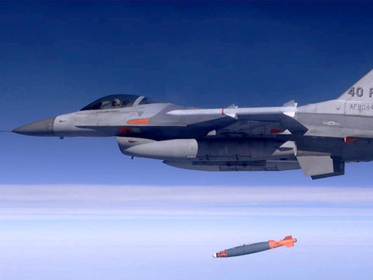 ** FILE ** An F-16 drops a JDAM-equipped bomb flying over Eglin Air Force Base in this April 18, 2002 file photo. The Joint Direct Attack Munition, or JDAM, became the most widely used air-delivered weapon of the war on terrorism in Afghanistan because of low cost, high accuracy and all-weather capability. The Pentagon is studying lessons learned from the war in Afghanistan and revising military tactics for what could be the next big battle: removing Saddam Hussein from power. (AP Photo/USAF, File)