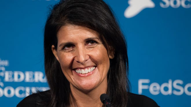 In this Friday, Nov. 18, 2016 photo, South Carolina Gov. Nikki Haley smiles while speaking at the Federalist Society's National Lawyers Convention in Washington. President-elect Donald Trump has chosen Haley as U.S. ambassador to the United Nations, and he will treat the ambassadorship as a Cabinet-level position, according to two sources familiar with Trump's decision who requested anonymity to discuss the decision and its announcement. Haley, an outspoken Trump critic throughout much of the presidential race, would become his first female - and first nonwhite - Cabinet-level official if confirmed by the Senate.