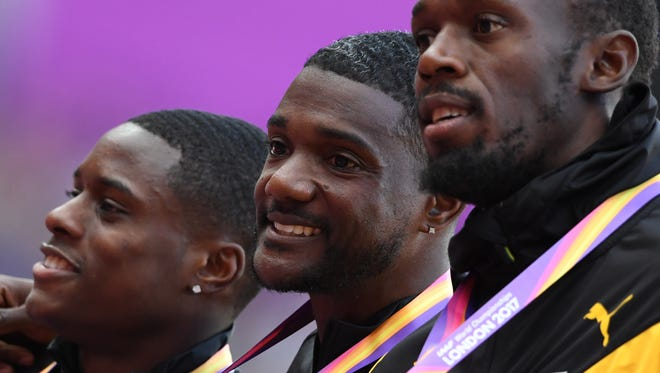 Silver medallist US athlete Christian Coleman (L), gold medallist US athlete Justin Gatlin (C) and bronze medallist Jamaica's Usain Bolt (R) pose on the podium during the victory ceremony for the men's 100m athletics event at the 2017 IAAF World Championships at the London Stadium in London on August 6, 2017.  / AFP PHOTO / ANTONIN THUILLIER        (Photo credit should read ANTONIN THUILLIER/AFP/Getty Images)