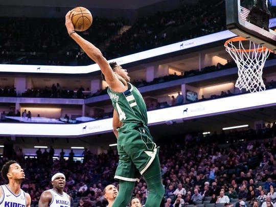Milwaukee Bucks forward Giannis Antetokounmpo dunks
