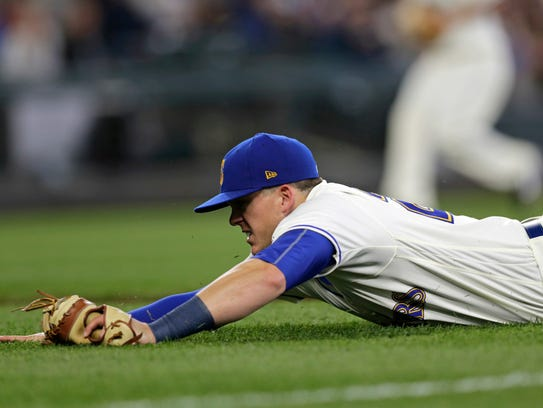 Seattle Mariners first baseman Ryon Healy completes