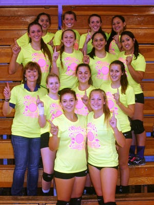 The Yerington Lions went 9-0 to win the Yerington Volleyball Invitational for the third straight season. The team poses wearing its championship T-shirts after defeating Dayton for the title.