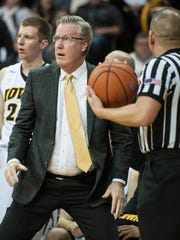 Iowa Hawkeyes head coach Fran McCaffery reacts to a