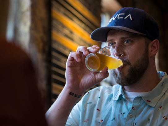 Stacy Harmsen enjoys a beer at Prairie Berry East Bank
