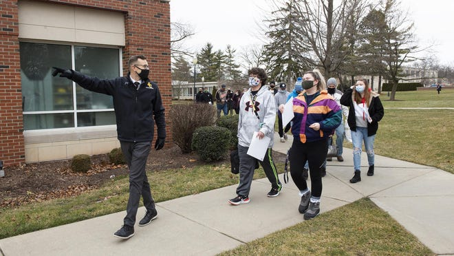 Joe VanGeison, Adrian College assistant vice president of enrollment, leads a group of new students during orientation on Jan. 11.