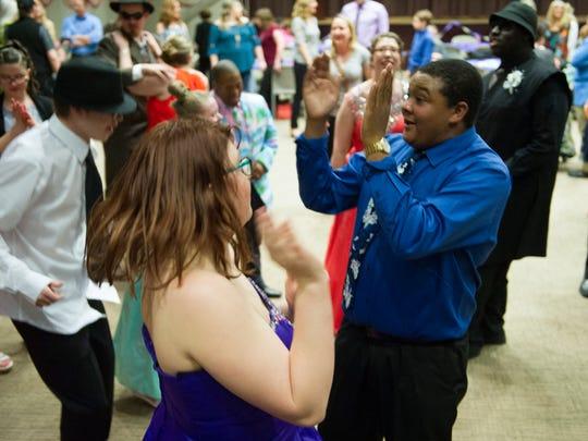 Tray Cox, right, dances with Elizabeth Ellis, and Bradford