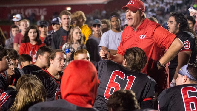 Halls coach  J.D. Overton congratulates his team on their 20-13 victory over Sevier County on Friday, October 20, 2017.