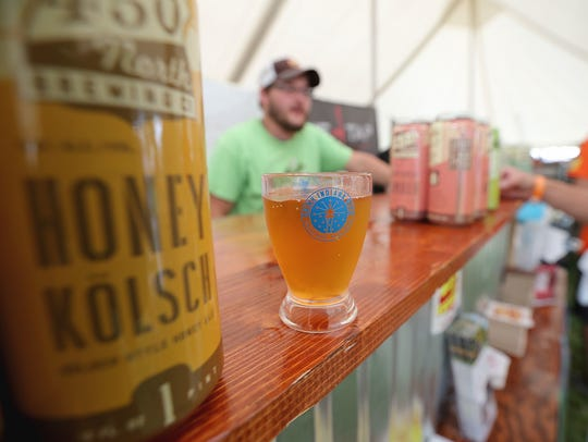 Sample hundreds of specialty beers at the Indiana Microbrewers Festival.