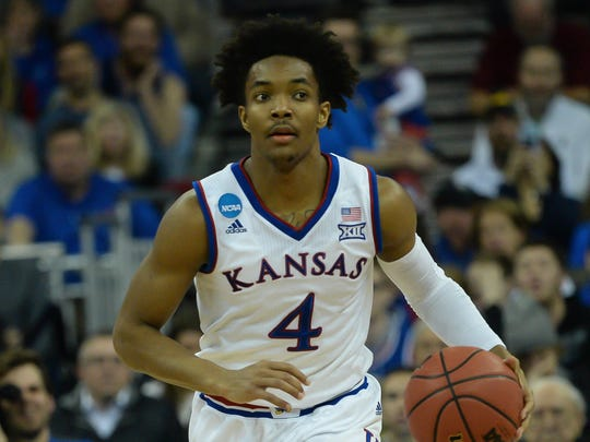 Kansas Jayhawks guard Devonte' Graham (4) in action against the Duke Blue Devils during the first half in the championship game of the Midwest regional of the 2018 NCAA Tournament at CenturyLink Center.