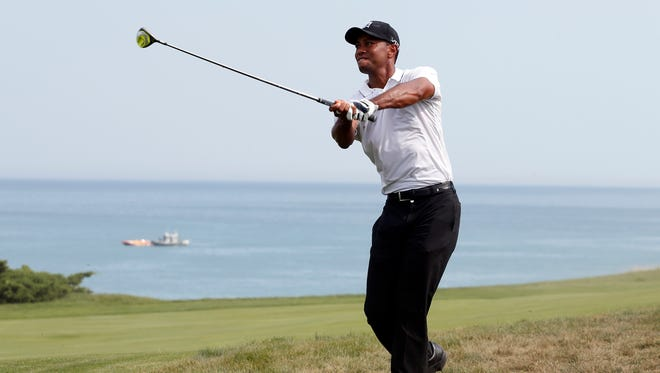 Tiger Woods plays from the rough of the 8th hole during the second round of the 2015 PGA Championship golf tournament at Whistling Straits.