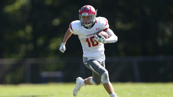 Tappan Zee's Kyle Daly carries the football during a 21-14 loss to Pearl River in the Orange Bowl at Pearl River High School on Saturday, Sept. 23, 2017.