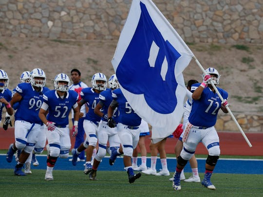 Members of the Bowie High School football team take the field for opening game celebrations. The Bears took on the Andress Eagles at Bowie Stadium Thursday night.