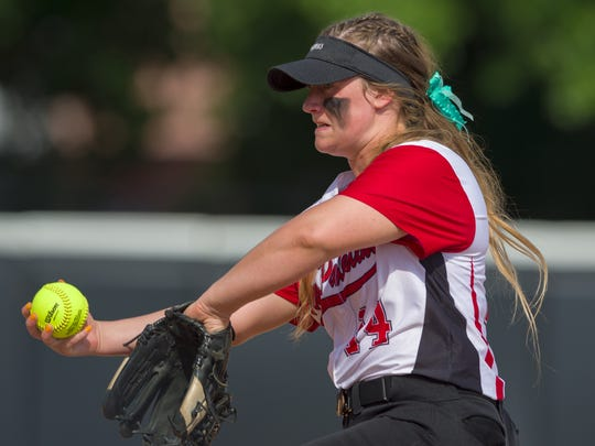 New Palestine High School senior Mackenzie Jones (14) delivers a pitch during the 34th Annual IHSAA Softball State Finals class 3A game, Saturday, June 9, 2018, at Bittinger Stadium on the campus of Purdue University, West Lafayette. New Palestine High School won over South Bend St. Joseph High School 3-1.