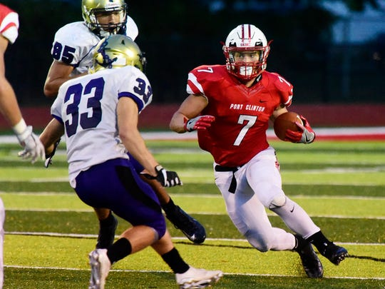 Port Clinton's Emerson Lowe carries the football against Vermilion.