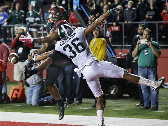 Michigan State cornerback Arjen Colquhoun gets a hand in to break up a pass to Rutgers wide receiver Leonte Carroo during the second half Saturday. This week, the Spartans travel to Ann Arbor to face U-M.