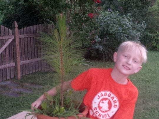 Travis Falk enjoys some time in the family's yard. The Falks enjoy time outside after dark in nice weather.