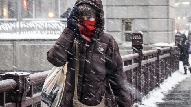 A person is bundled up in Chicago, Jan. 28, 2019.