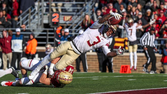 Florida State running back Cam Akers dives into the end zone against Boston College.