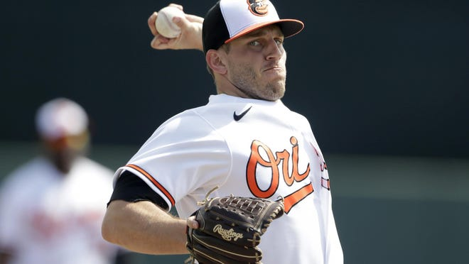 Baltimore Orioles starting pitcher John Means warms up before a Feb. 25 spring training game against the Tampa Bay Rays in Sarasota, Florida.