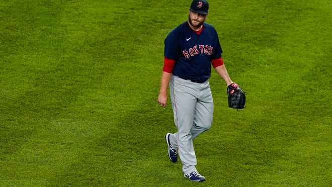 Boston Red Sox relief pitcher Ryan Brasier walks to the dugout after the fifth inning of a baseball game against the New York Yankees Friday, Aug. 14, 2020, in New York.