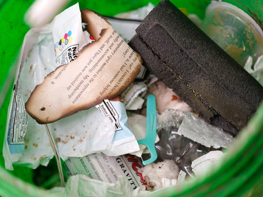 A variety of wrappers, papers and plastic picked up
