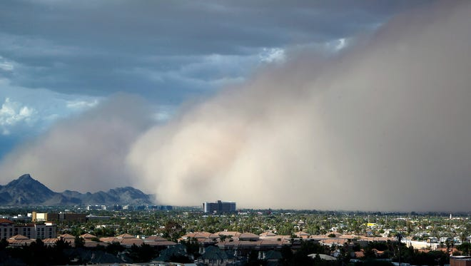 In this July 21, 2012 file photo a large dust storm, or haboob, sweeps across downtown Phoenix. Drought is tightening its grip across a wide swath of the American Southwest as farmers, ranchers and water managers throughout the region brace for what's expected to be more warm and dry weather through the spring. The federal drought map released Thursday, March 29, 2018, shows dry conditions intensifying across northern New Mexico and into southwestern Arizona. Every square mile of Nevada and Utah also are affected by at least some level of dryness.